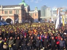 Many people participating in a rally in front of Seoul station