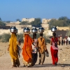Photo: Indian women carry water. ©Shutterstock/gnomeandi