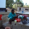Picture of african woman washing dishes