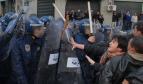 Police confronting demonstrators in Algeria