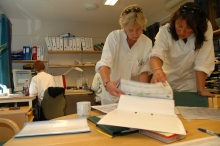 Health sector workers checking through files