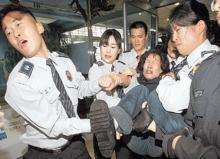 Korean police dragging away a female protestor