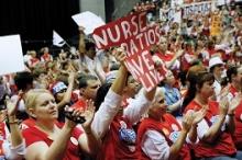 "Nurses demonstrating with banner ""Nurse ratios save lives"""