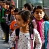 Children queuing up outside a charter school