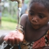 Young girl at a water fountain